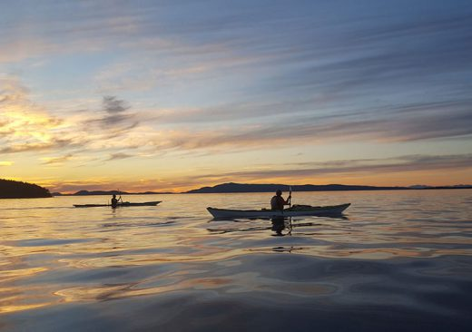 Sea Kayaking as the sun sets in the San Juan Islands