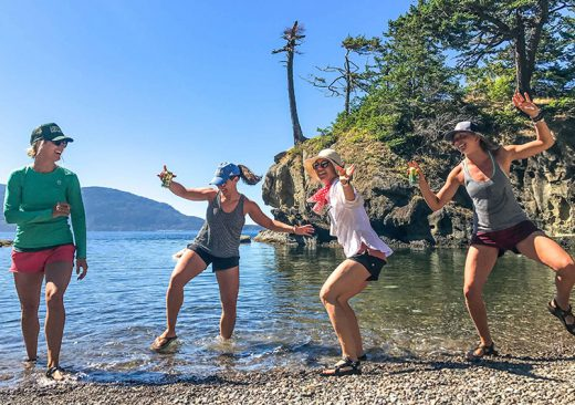 Women kayakers having fun on the beach